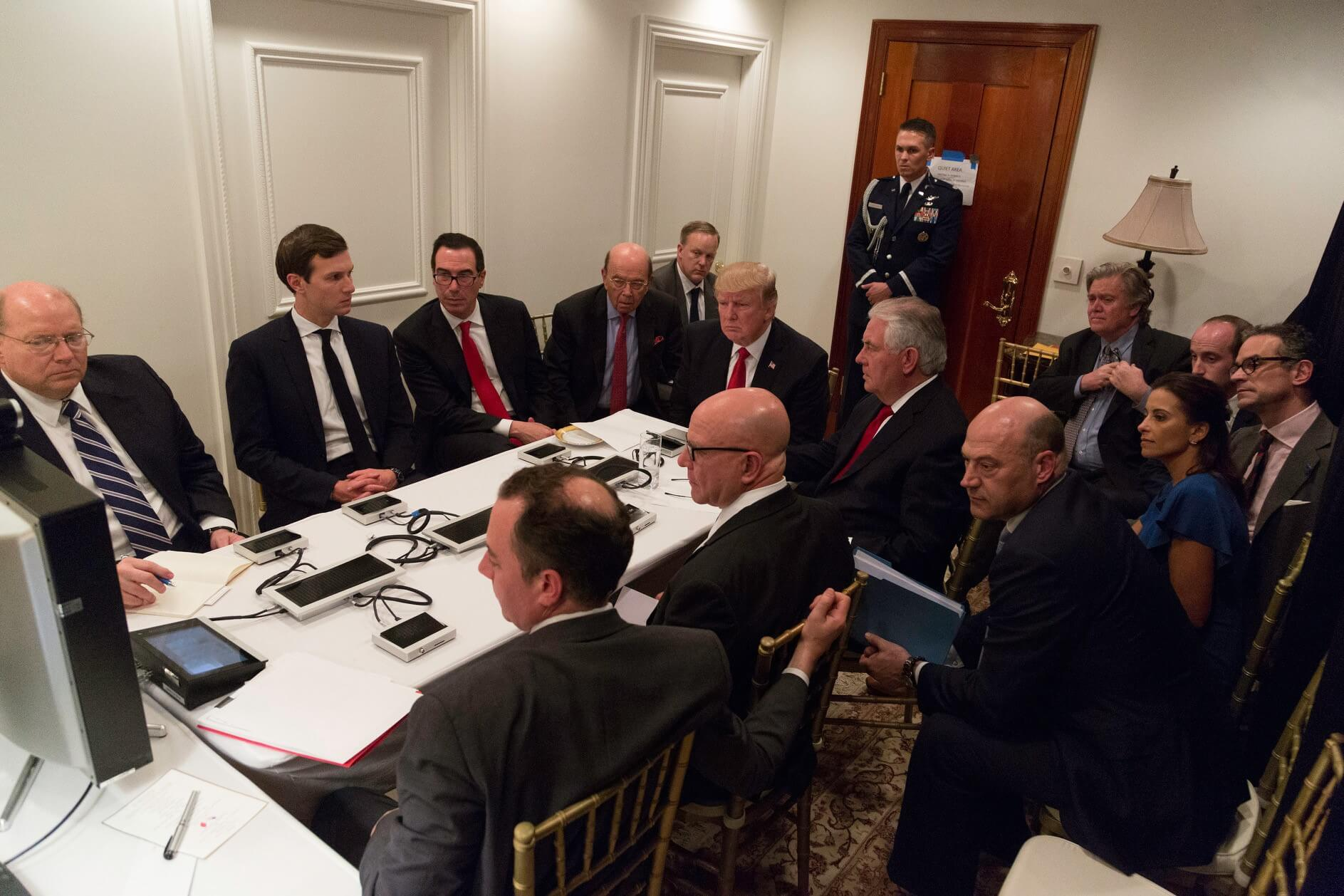 President Donald Trump receives a briefing on a military strike on Syria from his National Security team
